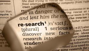 research_word_in_dictionary_magnified_sepia